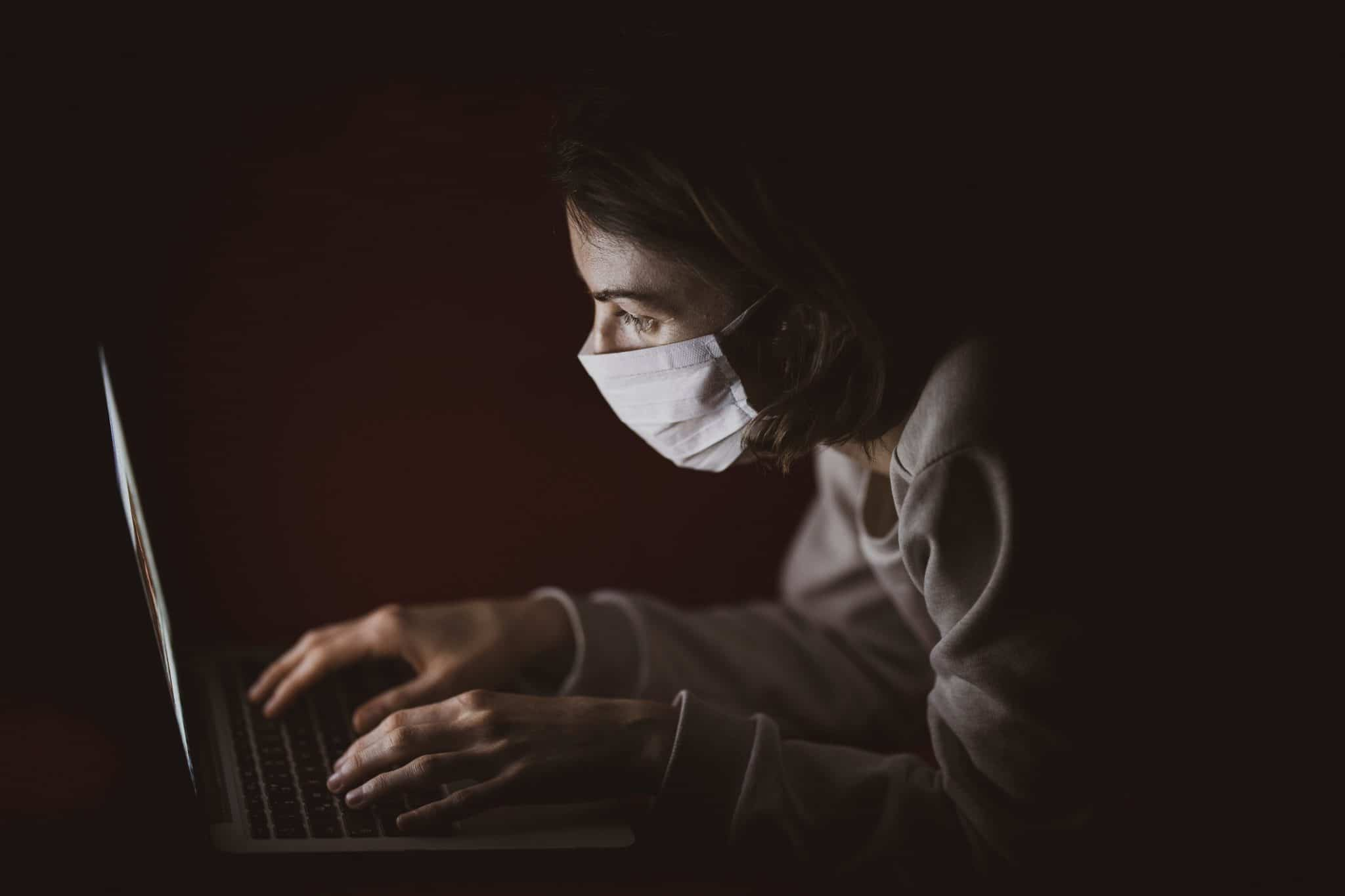 Women wearing face mask on computer